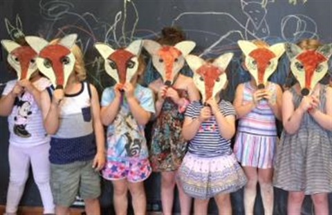 Children wearing fox masks at a Play School Party