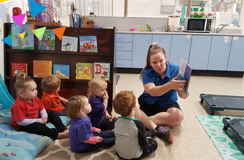Toddlers reading at City Child Care Centre