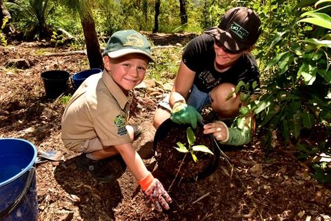 Owen planting a tree.JPG
