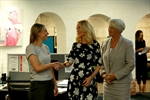 RHC Director Megan Gomez being congratulated by SmartHub Business Manager Elize Hattin and Mayor Margaret Strelow.jpg