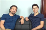 Daniel Johnsen and Ben Kennedy sitting on a black couch