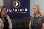 QLD's Chief Entrepreneur Leanne Kemp and Elize Hattin sitting on a couch in front of SmartHub banner