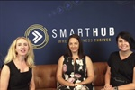 Elize Hattin, Crystal McGregor and Belinda Scott sitting on a tan couch in front of SmartHub logo