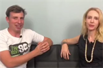 Wes Alan and Elize Hattin sitting on a black couch