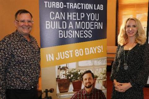 Photo of Monte Huebsch and Elize Hattin standing in front of the Turbo Traction Lab banner