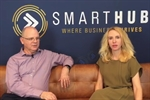 Drew Stevenson and Elize Hattin on a tan couch with SmartHub logo behind