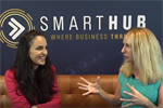 Tamara Loehr and Elize Hattin sitting on a couch in front of the SmartHub logo